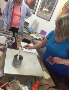 Gina giving a demonstration of her encaustic work.